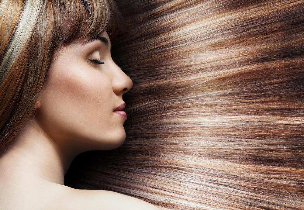 woman-with-shiny-brown-hair-with-highlights